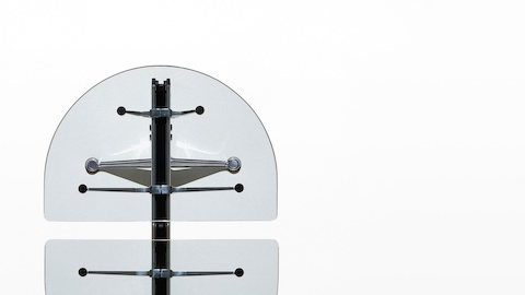 Overhead view of a Burdick table, showing the central aluminum beam beneath the glass top.
