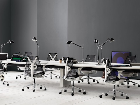 Sayl Chairs with black backs and white frames at Canvas Beam workstations with task lighting.