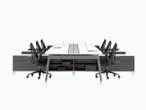 View down the length of a set of Canvas Beam workstations with black upholstered Sayl Chairs and dark gray storage.