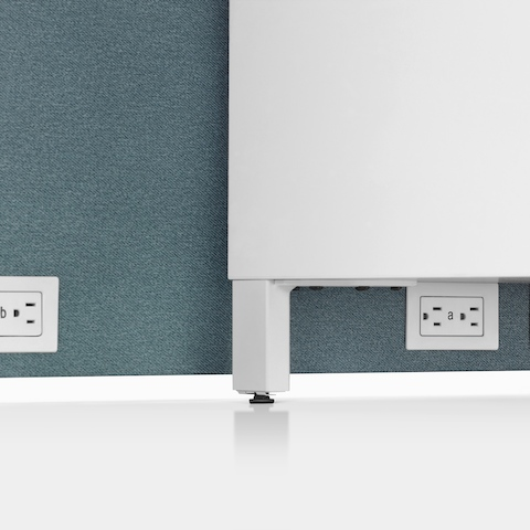A close-up image of power access in a blue fabric boundary on a Canvas Channel workstation.