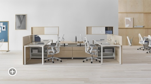 A Canvas Vista workstation with white Mirra 2 office chairs. Select to go to the Individual Workstations page within the Canvas Lookbook.