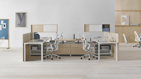 A Canvas Dock workstation in light wood and white with grey Mirra 2 office chairs.