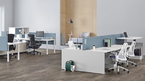 Canvas Channel and Canvas Dock workstations with blue panels, positioned near a lounge area.