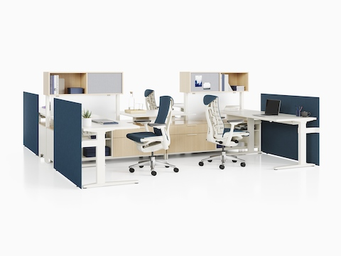 A Canvas Dock workstation with light wood, white surfaces, and blue Mirra 2 office chairs.