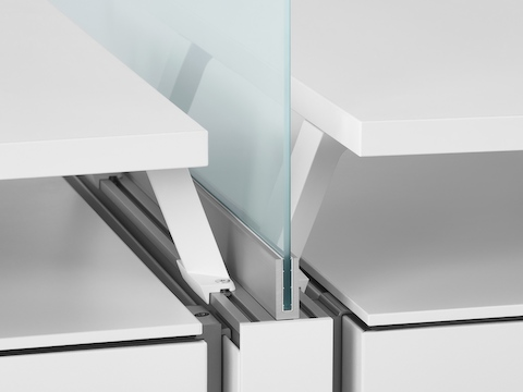 A close-up image of a glass screen boundary between two Canvas Dock workstations. Select to go to the Canvas Dock specs page.