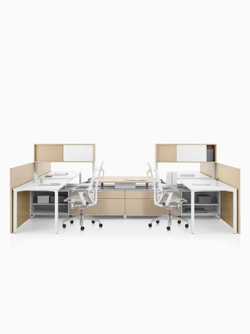 A Canvas Dock workstation with light wood storage and white Mirra 2 office chairs. Select to go to the Canvas Dock product page.