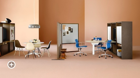Two collaborative spaces with Canvas Group and Eames tables, blue and brown Eames chairs, display monitors and writeable and tackable surfaces. Select to go to the Collaborative Workspaces page within the Canvas Lookbook.