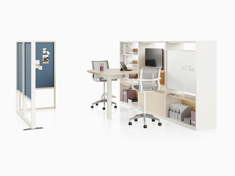 A Canvas Group collaboration space with storage wall, a display, and grey Setu stools.