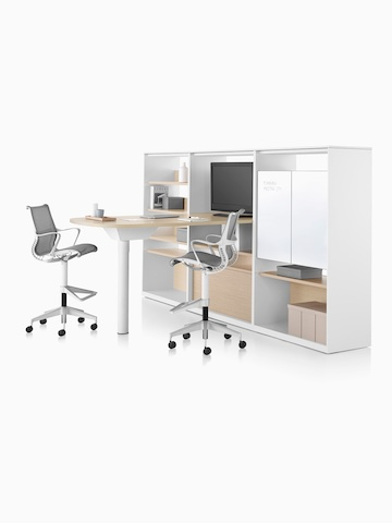 A Canvas Group collaboration space with white surface, display, storage, and grey Cosm office stools. Select to go to the Canvas Group product page.