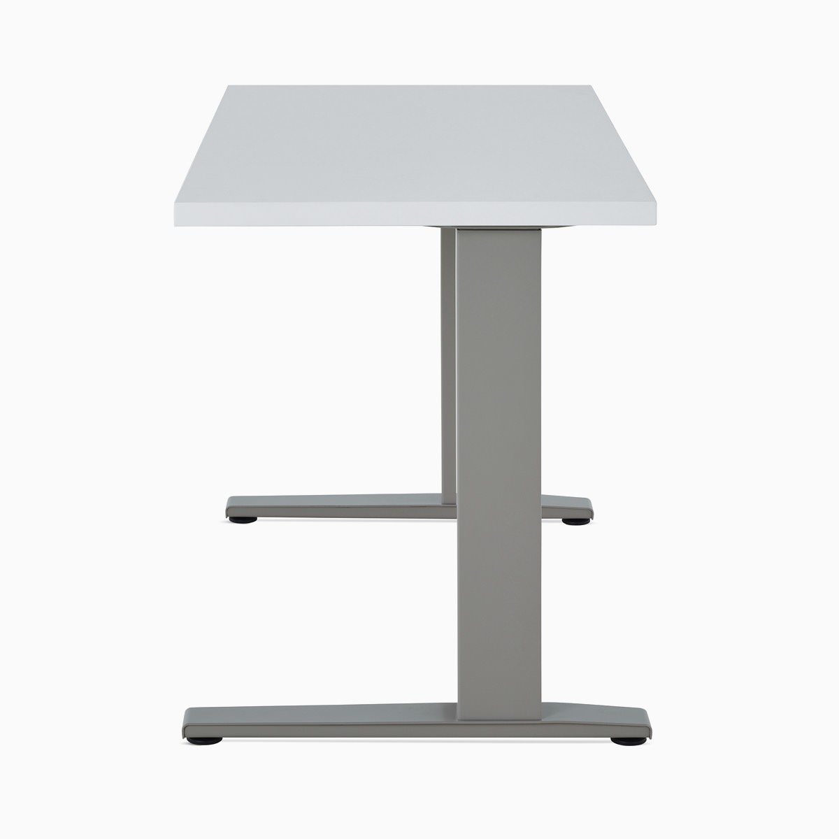 A white Motia Sit-to-Stand Table with gray legs.