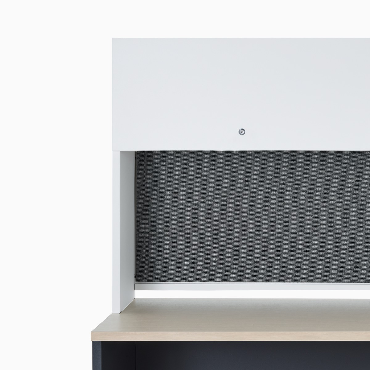A close-up of a Canvas Metal Desk flipper overhead storage.