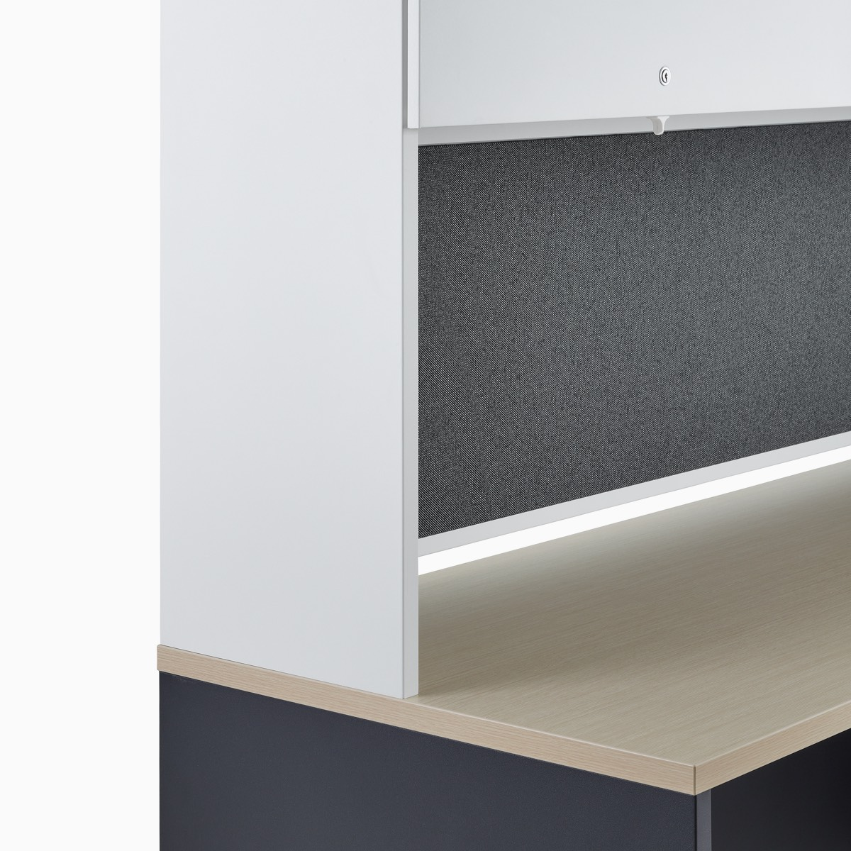 A white overhead storage with closed stanchion, part of a Canvas Metal Desk.