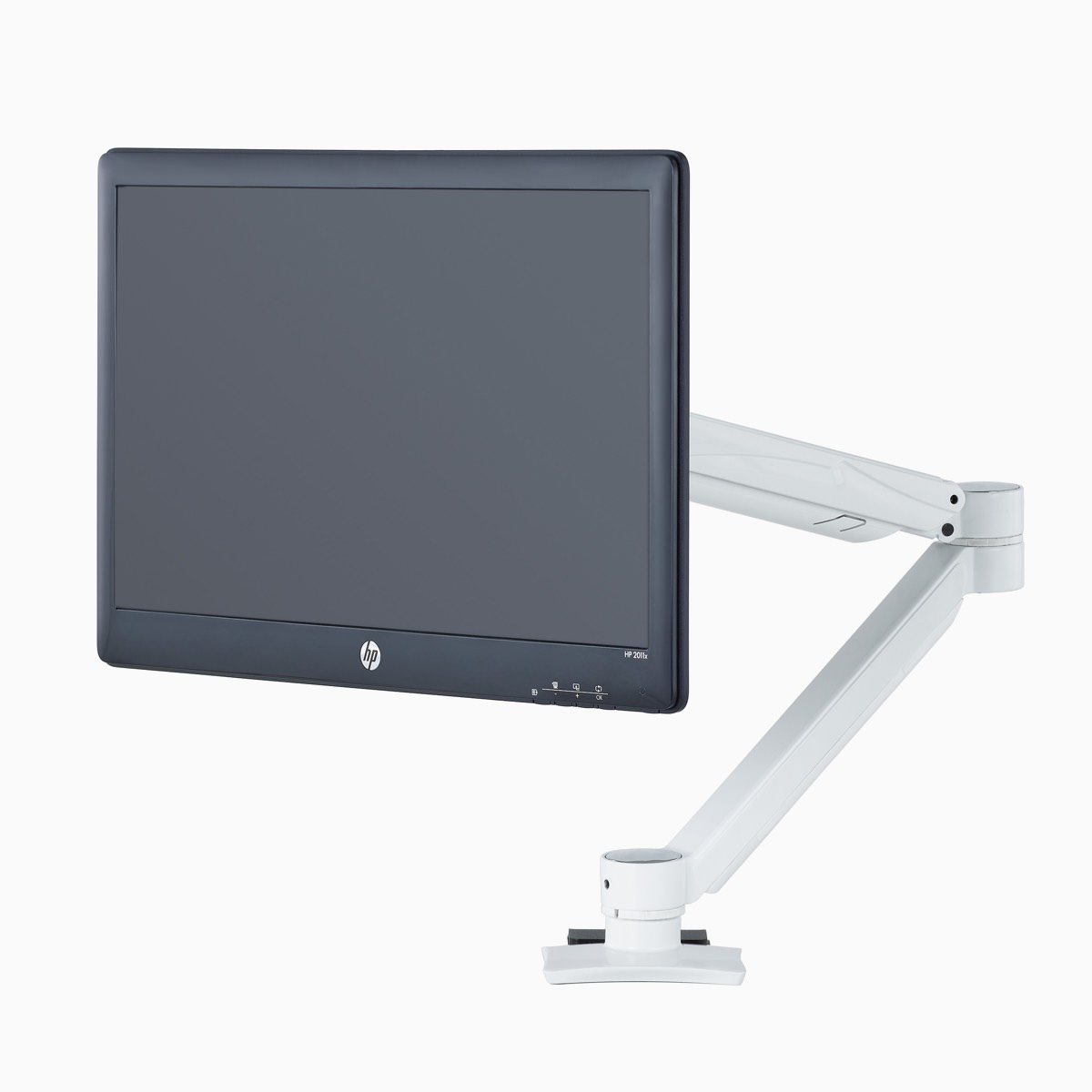 A white Concerto Monitor Arm with a black monitor.