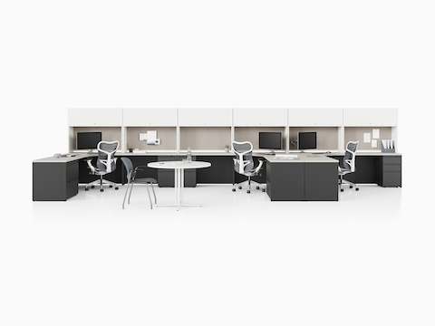 Canvas Metal Desks with dark gray storage units, white upper storage, and tack boards.