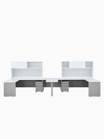 Two white and gray Canvas Metal Desks with upper storage and a peninsula surface.