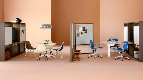 Two Canvas Group settings with Eames Shell Chairs and blue Eames Aluminum Group Chairs, designed to foster collaboration.