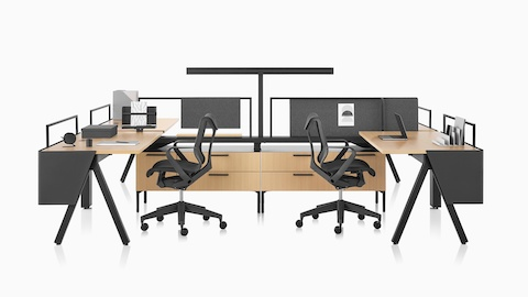 Brown and black Canvas Vista workstations with a-shaped legs, modesty screens, t-shaped light, and black Cosm chairs.