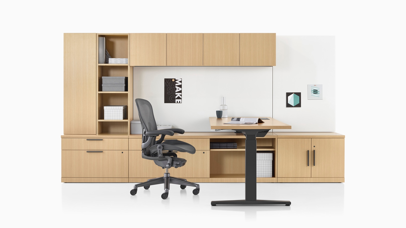 A Canvas Private Office with light wood storage, height-adjustable desk, and black Aeron office chair.