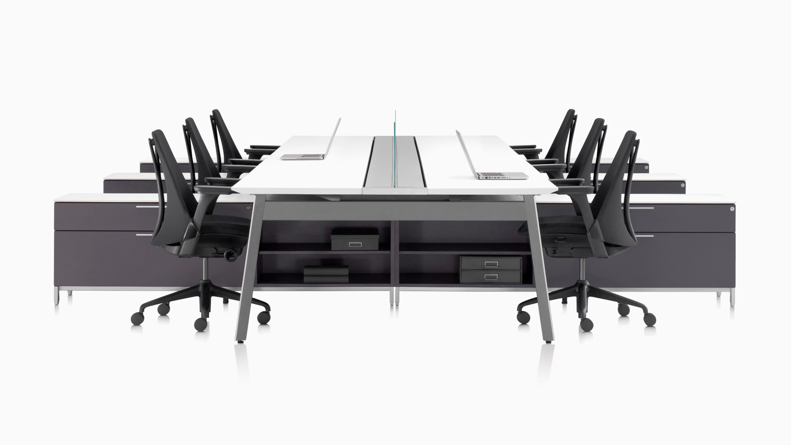 A Canvas Beam workstation with black Sayl office chairs.