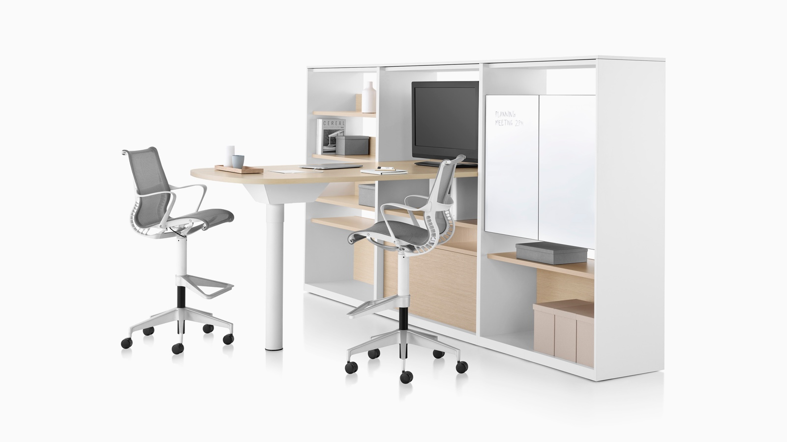A Canvas Group collaboration space with white surface, display, storage, and grey Cosm office stools.