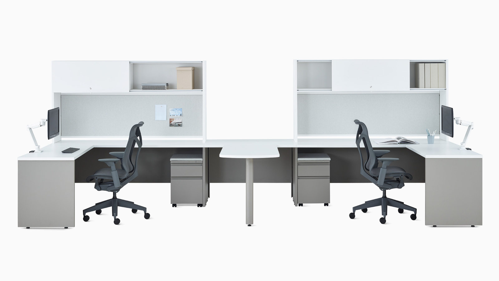 Two white and gray Canvas Metal Desks with upper storage, Concerto Monitor Arms, and dark gray Cosm Chairs.