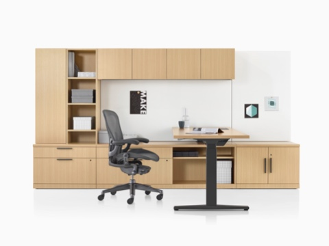 A Canvas Private Office with light wood storage, a height-adjustable desk, and a black Aeron office chair.