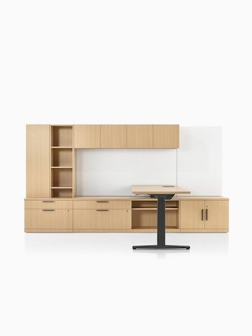 A Canvas Private Office with wood storage and a height-adjustable desk.