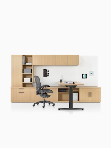 A Canvas Private Office with wood storage, a height-adjustable desk, and an Aeron office chair. Select to go to the Canvas Private Office product page.
