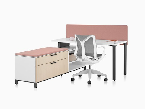 A Canvas Storage workstation with a white surface, pink screen, and grey Cosm office chair.