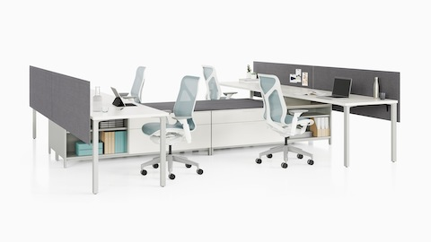 A Canvas Storage workstation with white surfaces, grey screens, and light blue Cosm office chairs.