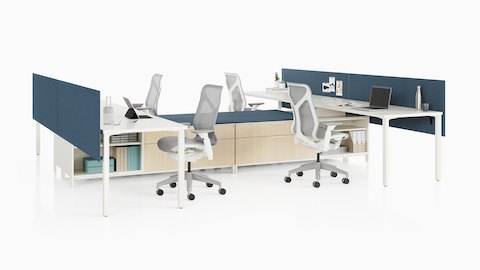 A Canvas Storage workstation with white surfaces, blue screens, and light grey Cosm office chairs.