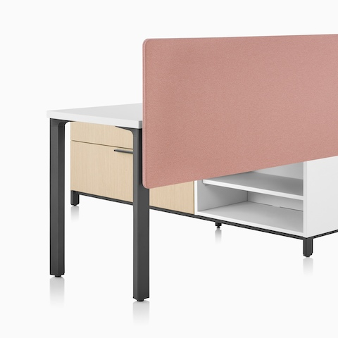 A Canvas Storage workstation in light wood with a white surface, pink screen, and graphite legs.