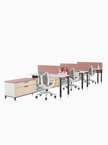 A Canvas Storage workstation with white surfaces, pink screens, and grey Cosm office chairs. Select to go to the Canvas Storage product page.