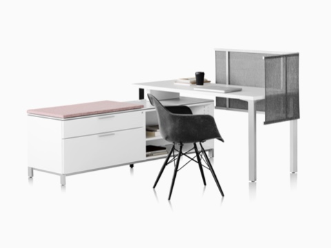 Canvas Storage workstation with Black Eames Molded Fiberglass Chair, white desk, white storage, and gray mesh screen.