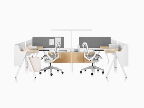 Canvas Vista workstations in light wood and white with modesty screens, t-shaped light, and grey Cosm office chairs.