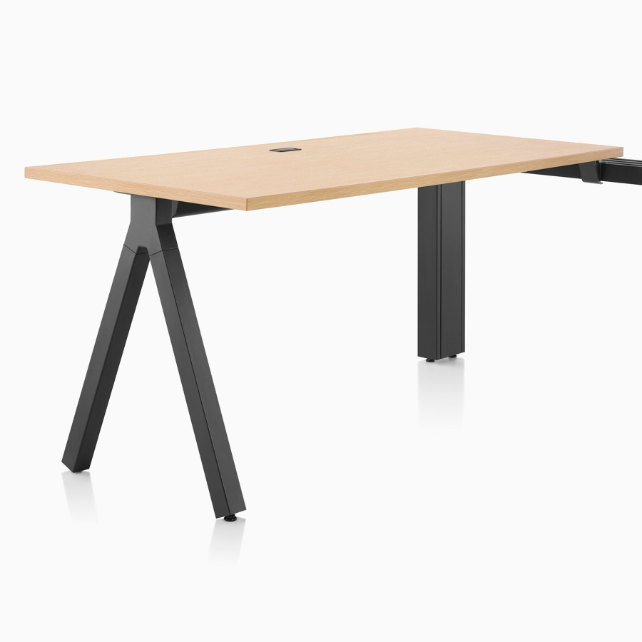 A light wood Canvas Vista fixed-height table with black a-shaped leg.