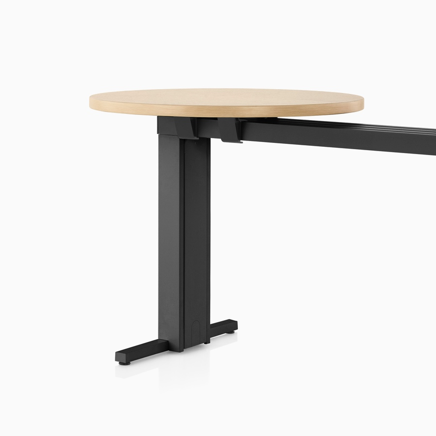 A light wood Canvas Vista café surface mounted on a black t-shaped leg and chase.
