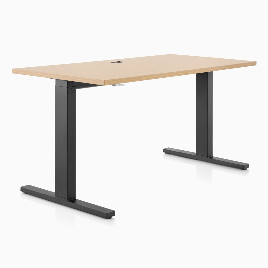 A light wood and black Motia height-adjustable table.