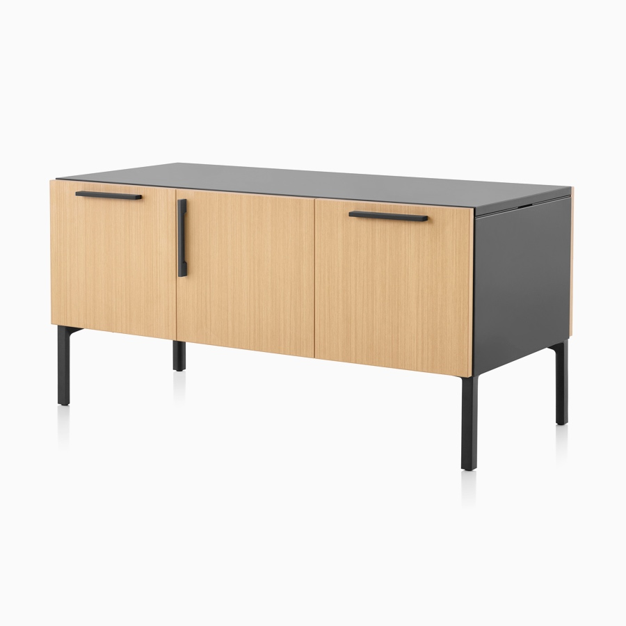 A light wood and black Tu Wood shared credenza with file, medicine cabinet, and tip-out bin.