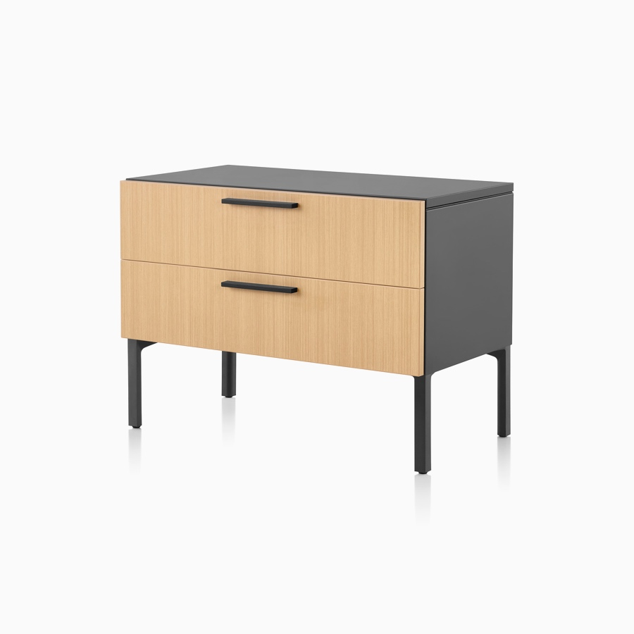 A light wood and black Tu Wood individual credenza with 2 box drawers.