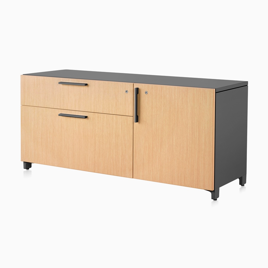 A light wood and black Tu Wood individual credenza with 2 box drawers and doors.