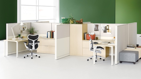 Two Canvas Wall workstations in light wood with black Mirra 2 office chairs.