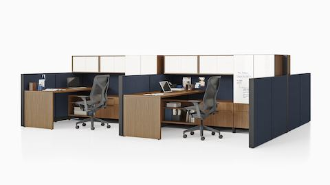 Two Canvas Wall workstations in dark wood with blue panels, white overhead storage, and black Cosm office chairs.