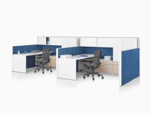 A Canvas Wall workstation with blue panels, white overhead storage, and dark grey Cosm office chairs.