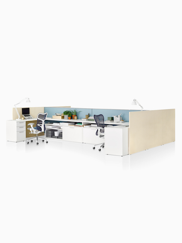 Two open workstations configured from Canvas Wall components.