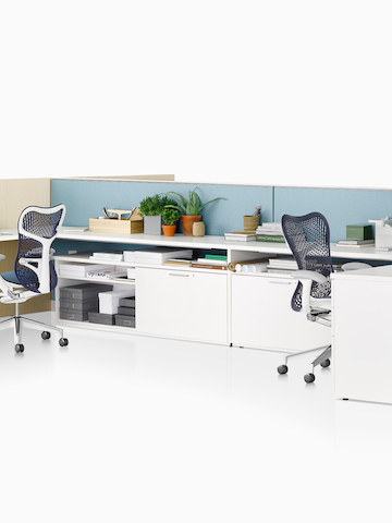 Two open workstations formed from Canvas Wall-Based panels. Select to go to the Canvas Wall-Based product page.