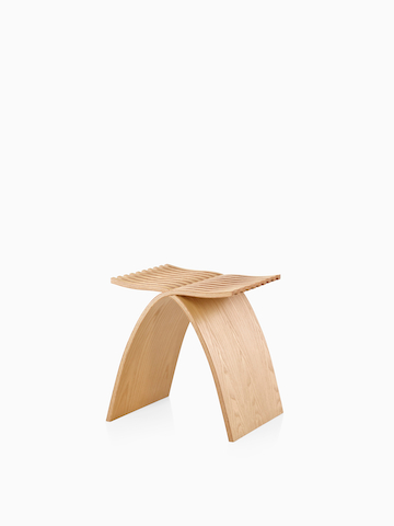 Angled view of a Capelli Stool in a light wood finish.