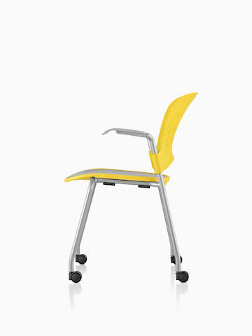 Profile view of a yellow Caper Stacking Chair with casters.