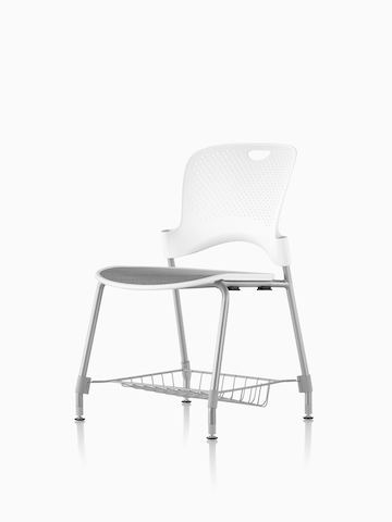 White Caper chair with suspension seat, metal legs, and storage basket underneath the seat.