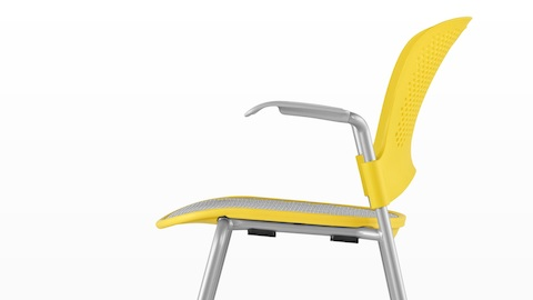 Profile view of a yellow Caper Stacking Chair with a suspension seat.